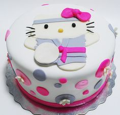 Cute karate hello kitty cakes with grey and bright pink cake decors.PNG