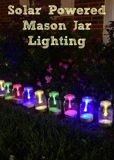 How to make solar powered mason jar lights with with string lighting. Beautiful outdoor mason jar lighting.