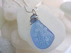 Hand painted cornflower blue sea glass necklace by Alienstoatdesigns, £19.00
