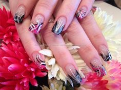 Pink black and white freehand flick nail art over acrylic nails