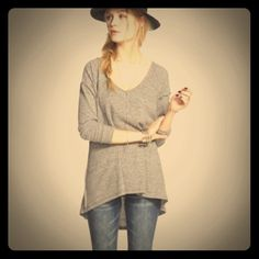 """Sun and Shadow V-Neck Thermal Swing Top size M Sun and Shadow V-Neck Thermal Swing Top size M Gray NWT NEVER WORN!  This cozy long-sleeve tee is made with soft ribbed jersey and raised seam lines that highlight the swingy construction. 24 1/2"""" front length, 29"""" back length (size Medium). V-neck. Long sleeves. 50% polyester, 38% cotton, 12% rayon. Machine wash cold, dry flat. By Sun & Shadow; imported. BP. Sun & Shadow  Tops Tunics"""