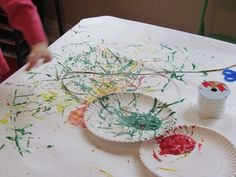 Ribbon painting can lead into Eric Carle lesson or other collage project.  Printmaking........paper covered table.