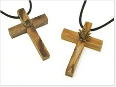 """THIS IS A VERY HIGH QUALITY OLIVE WOOD LATIN STYLE 2 INCH CROSS PENDANT (NECKLACE). IN THE CENTER IS SET THE """"MARY'S BLESSING FLOWER"""". THE FLOWER OPENS ITSELF AFTER RECEIVING FEW WATER DROPS, THE RIGHT TIME TO THINK ABOUT YOUR WISHES AT  $37...  http://www.marysblessing.com/"""