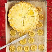 ingredients  1 recipeSingle-Crust Pie Pastry, see recipe, or 1 rolled refrigerated unbaked piecrust (1/2 of a 15-oz. pkg.)  2 eggs  1/3 cup butter, softened  1 cup granulated sugar  2 teaspoons finely shredded lemon peel  1/4 cup lemon juice  2 tablespoons all-purpose flour  1/8 teaspoon salt  1 cup milk  1 recipeCandied Lemon Slices (see recipe below) (optional)
