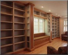Someday we hope to own a home of our own in the city, and when that day comes, we want a home library like this one. This stunning wall of built-ins was created by craftsman Tony O'Malley of Emmaus PA, and we have to admit that all these empty shelves call to us...
