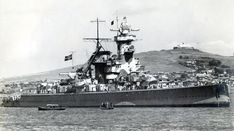 11 in 'pocket battleship' Admiral Graf Spee in Montevideo harbour on 14 December 1939 after her battle against three British cruisers the preceding day: she was to be scuttled shortly thereafter; short of ammunition and forced to emerge from the neutral Uruguayan port, her Captain had been convinced (falsely) by British intelligence that overwhelming force awaited her.