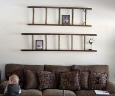 Vintage wood ladder wall decoration over couch. So many people find ladders in the trash