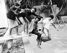 The Beatles messing around on a diving board 1964 | Rare and beautiful celebrity photos
