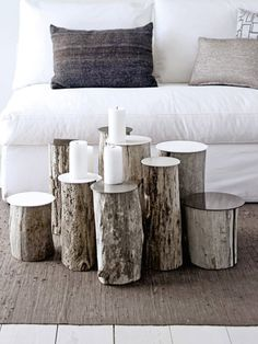 various heights of logs as a coffee table or candle holders - Poppytalk: Real Living - March Interior And Exterior, Interior Design, Diy Home, Home Decor, Diy Casa, Deco Originale, Living Spaces, Living Room, Cool Coffee Tables
