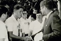 Bill Clinton Meets With John Kennedy: While a teenager, Clinton got to meet and shake hands with then-current president John F. Kennedy. (Photo Credit: Bettmann/CORBIS)