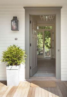 A clean, warm welcome. We recommend Simply White, or even Snowfall White, for the exterior walls, with a soft gray such as Stonington Gray for the door and trim.