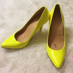 Neon yellow heels Neon yellow heels great condition! Small knick on back left heel ALDO Shoes