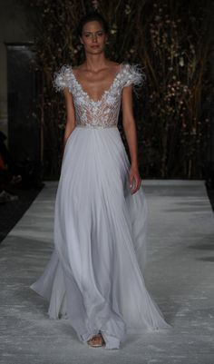 Mira Zwillinger gown with plunging neckline and feathered-sleeves | Mira Zwillinger Spring 2017 | https://www.theknot.com/content/mira-zwillinger-wedding-dresses-bridal-fashion-week-spring-2017