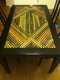 Officially made a beer bottle cap table!!! Made by @Sami McLaughlin and myself!