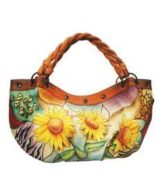 f85342410fd Love this Anuschka Handbags Sunflower Safari Braid-Strap Hand-Painted  Leather Hobo by Anuschka Handbags on