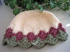 FREE CROCHET PATTERN Diamond Edge Hat, rose, green & ivory.  The link for the pattern is on this page.  Directed to this page first because there are several examples in different color combinations.