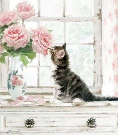 Pretty tabby kitten curious about the flowers.