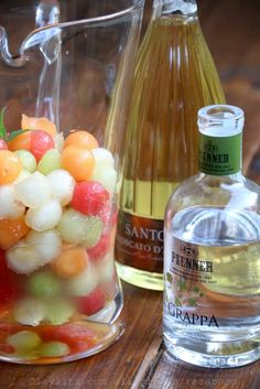 Mix the melon balls with the honey, lime juice and grappa