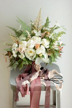 Early June white and peach bridal bouquet designed by Love 'n Fresh Flowers with custom ribbon by Silk & Willow.