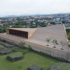 Mexican architect Isaac Broid and firm Productora has created a stone-clad performing arts venue in central Mexico that borders an archaeological site.