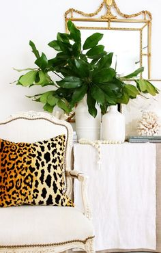Leopard pillow on white antique side chair.