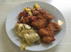 fried chicken with salad and pasta with mushrooms and leek.