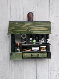 Handmade shelf perfect for your bathroom or display at trade shows, barber shops and much more. Made with Douglas fir, white pine and some reclaimed pallet wood it comes ready to hang or works sitting on a surface as well. This one is Stained green and black for a appealing look and comes with a quart size mason jar! Perfect for your apothecary display!   Double coat of satin polyurethane for preservation and protection!  All other items pictured do not come with shelf.  Free shipping till…