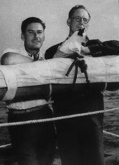 Errol Flynn and his Siamese Bes Mudi, and Errol's father, Dr. Thompson Flynn  aboard the schooner Zaca on which they sailed to begin a scientific expedition of Pacific waters off the coast of Mexico and South America.