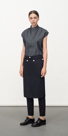 Ahead of Fashion Week in Tokyo next month, we're turning our eye to a pair of rising Japanese talents that at first glance, could scarcely be more different. Grey Fashion, Minimal Fashion, Fashion Design, Minimal Style, Ladies Fashion, Bartender Uniform, Restaurant Uniforms, Uniform Design, Japanese Fashion