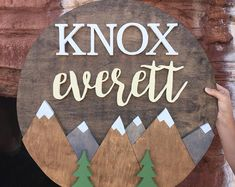 24 Inch Round Custom Name Sign with Mountains Nursery name Sign Wood cut out Name cut out Nursery decor Wood baby name Wall hangin - Nursery name, Baby names, Mountai - Unusual Baby Names, Cute Baby Names, Boy Names, Nursery Name, Nursery Wall Decor, Themed Nursery, Nursery Ideas, Wood Nursery, Playroom Ideas