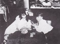 Elizabeth Bowes-Lyon and her brother making a house of cards.