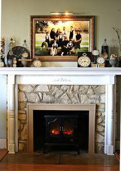 I LOVE how she took a boring rock fireplace and added her own DIY mantle!  It looks fabulous!