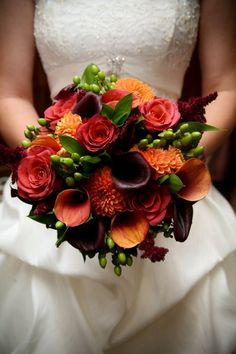 love these.. orange roses, green hypericum berries, orange dahlias and cala lilies (mango and black forest)