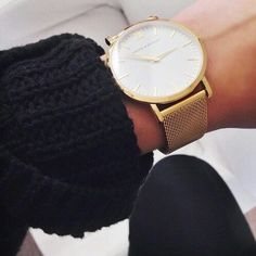 Like the big gold watch. I'm picky about watches--I like really simple, classic designs. I also like the black chunky knit on this cuff.