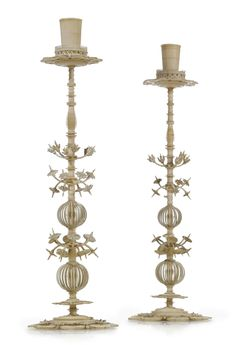 A pair of South German turned ivory and bone candlesticks, late 17th century.