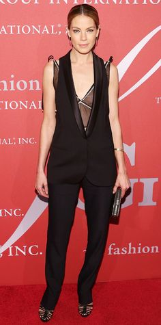 To support designer Joseph Altuzarra at the 31st Annual Fashion Group International's Night of Stars event, Michelle Monaghan stunned in Altuzarra separates—a sheer top layered under a tuxedo vest with black tailored pants. Graziela Gems earrings, a Melinda Maria ring, an EFFY Jewelry bangle, a metallic clutch and Altuzarra heels completed her sharp look.