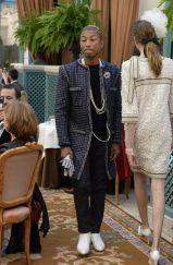 Pharrell walks the Chanel Métiers d'Art show at the Ritz earlier this month.