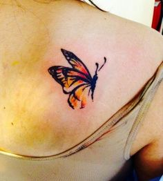 Small red watercolor butterfly tattoo