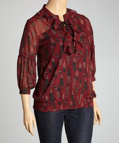 A row of ruffles at the neckline adds a touch of romance to this breezy chiffon top, while the soft silhouette and banded hemline provide a feminine fit.Measurements (size 1X): 28'' long from high point of shoulder to hem100% polyesterMachine wash; tumble dryImported