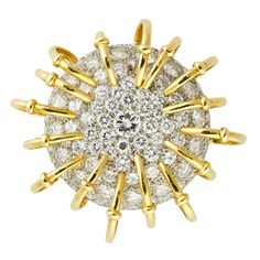 """Rare and unusual 18k yellow gold and platinum diamond circular brooch from the """"Apollo"""" collection by Tiffany & Co, Schlumberger. It features approx. 8.0cts of very high quality round brilliant cut diamonds, pave set on a platinum bombe` mount, with yellow gold looped wires around the diamonds for a sun-like effect."""