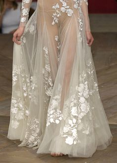 Valentino. Objectification of women's body parts is not fashionable, it's sexism and reflects poorly on the designer and the woman who agrees to wear the skanky rag. Show that much skin on a man and then we can talk about equality!