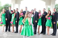 Cute flower girl pose.  Could have ring bearers and flower girls in that pose with wedding party in the background.