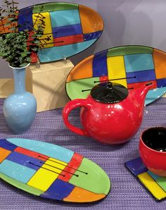 Color, our favorite way to lift spirits with no side effects!  Trays by Wendy Bedolla, tea set by Judith Weber.