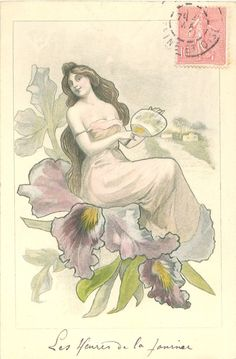 girl in pink sits in purple iris