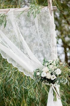 Greenery and lace ceremony arch   Limelight Photography