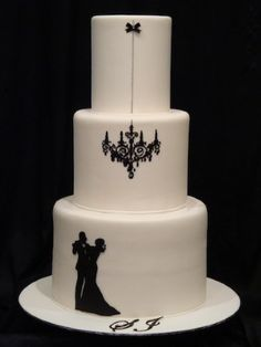 Silhouette 's are so beautiful on cakes! I think it would be cute to do the bride and groom's silhouettes.