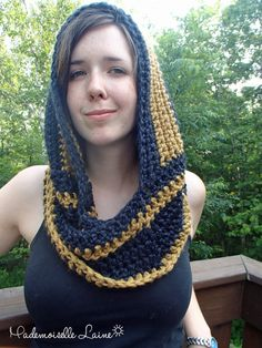 This handknit hooded infinity scarf is handknited with a black and gold yarn made of wool for warmth and softness and nylon for resistance. It will look great with a nice coat for winter.