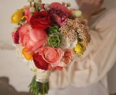 Beautiful victorian bouquet with Paeonies, Carnations, Ranunculus and Brunia.