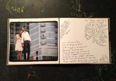 A photo book from the engagement shoot makes a perfect guest sign in book at the wedding reception