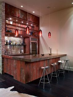 Dark stained Red Oak hardwood floors go great with the rustic bar in this Man Cave.